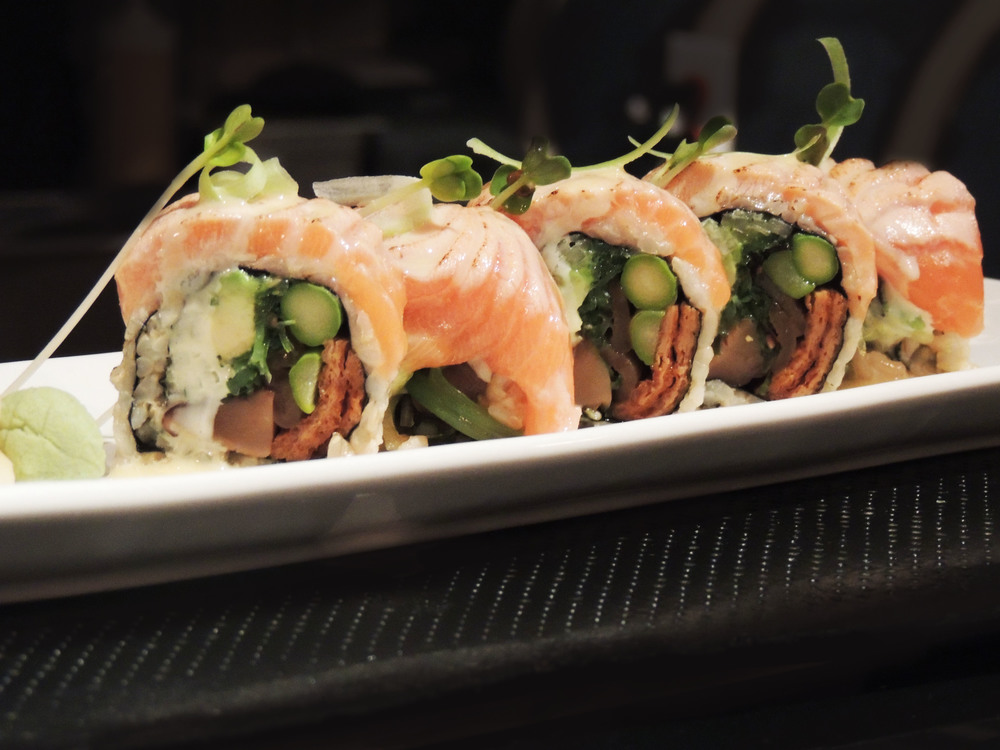 Our Special Zen Roll topped with Seared Salmon, a celery garnish and a honey yuzu glaze.