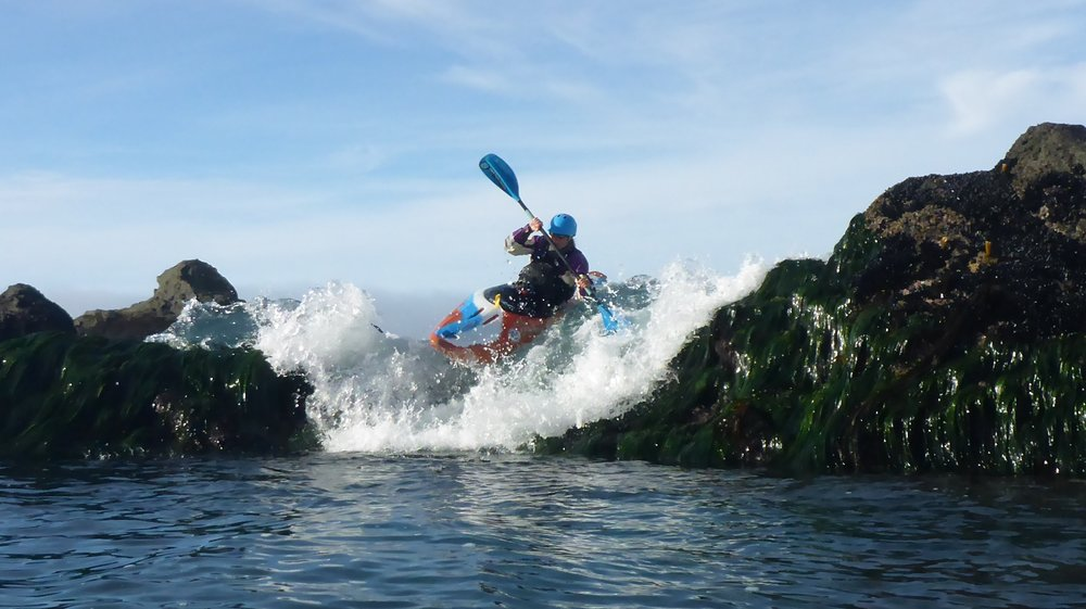 LFK's Cate Hawthorne gets a nice pour over ride in her whitewater kayak.