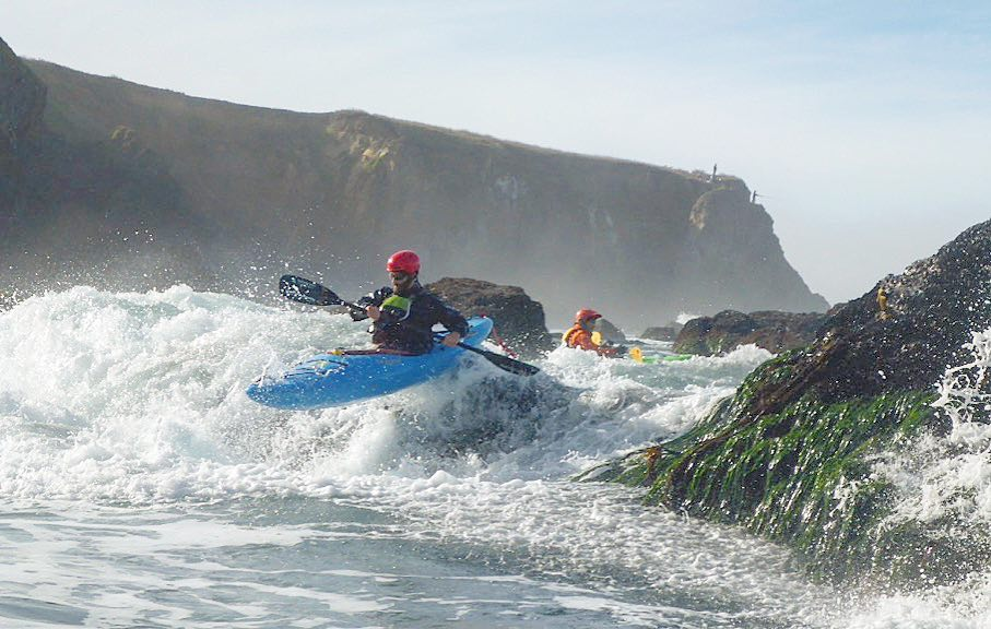 LFK's Jeff Laxier demonstrates a whitewater kayak boof stroke in the ocean.