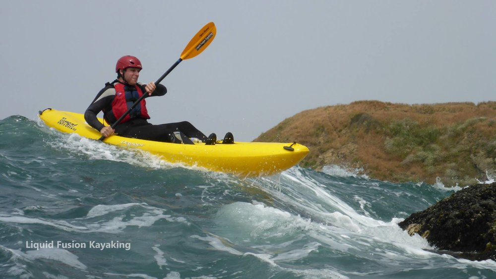 Kayaking ocean rock gardens in whitewater kayaks in Mendocino