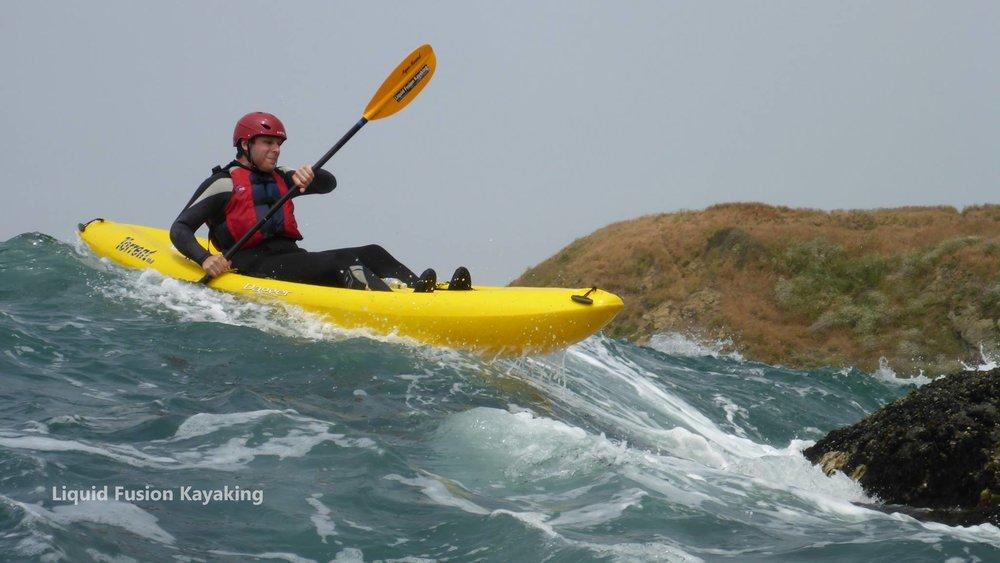 Kayaking ocean rock gardens in whitewater kayaks in Mendocino