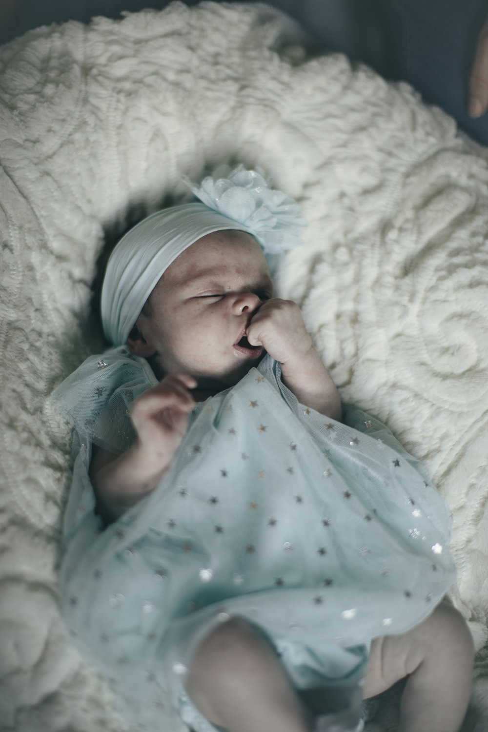 Esther, just three weeks old, at her newborn photoshoot in the little star dress I bought with her Grandma Wright the day before we went into labor! (Esther means star)