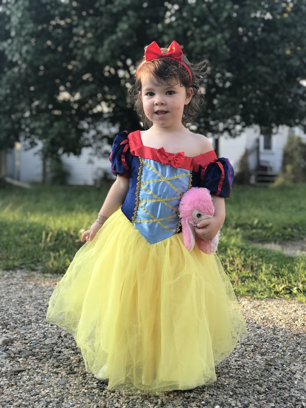 Her snow white dress, a gift for giving up her pacifier