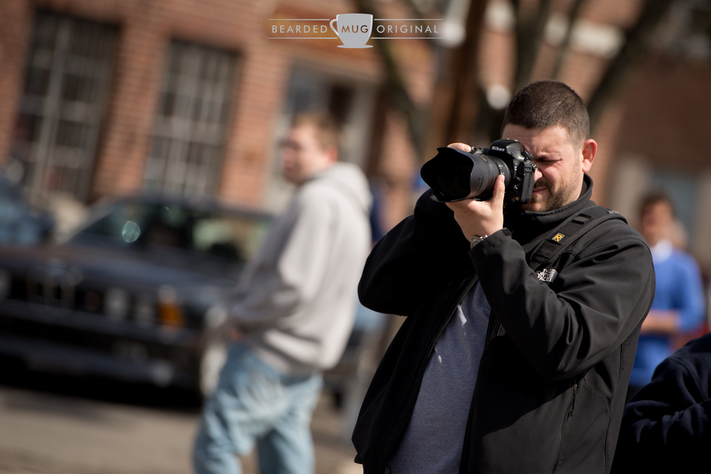 Fellow smart shooter, working his Nikon with the venerable 70-200 F2.8.