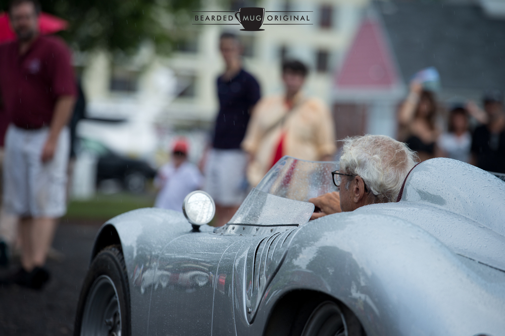 Although it rained during the Concours International awards portion, that did not deter most of the cars from crossing the podium, tops in place or not.