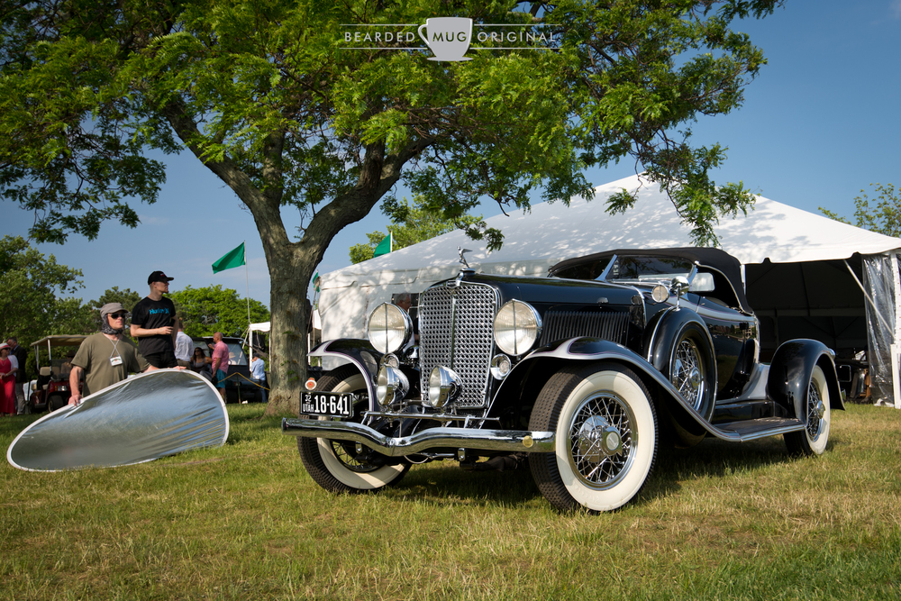 The notorious reflector, providing absolutely no fill light in the shadows of this  People's Choice  1932 Auburn 8-100A Custom Deluxe Boattail Speedster, one of just 84 produced. The Custom Deluxe model featured the different grill and covers on the side-mounted spares, among other fine details.