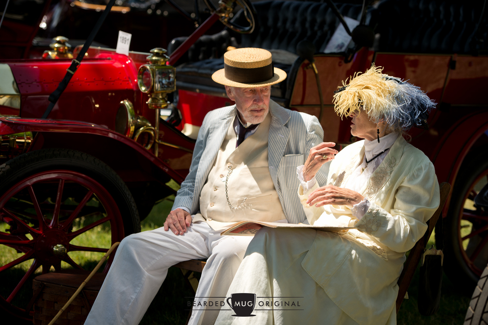 In similar fashion to other prominent shows, some attendees really dressed the part to match their Brass Era rides. You can't see it, but the publication on her lap isn't exactly the current  Daily News .