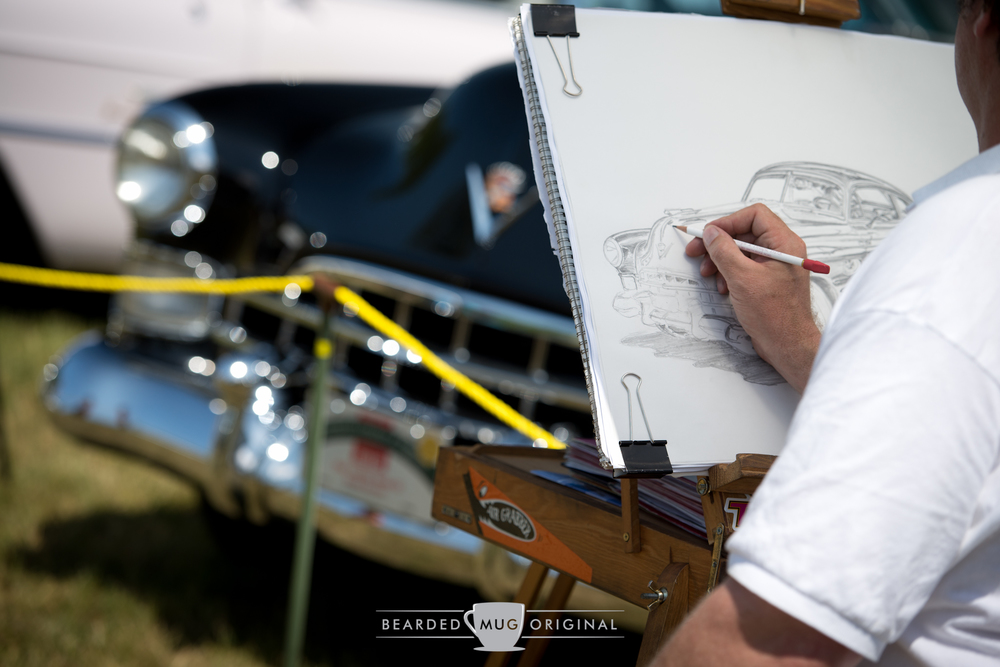 Talent: flaunt it if you've got it! I'm almost certain this artist was sketching the same car at the Waveny Park C&C back on Mother's Day.