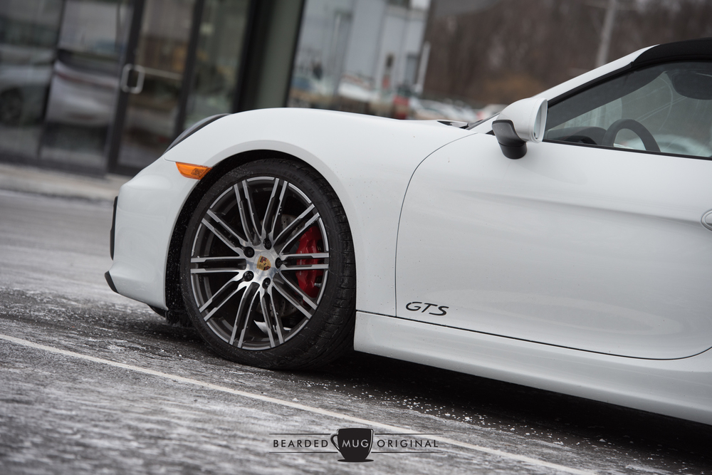 The Boxster GTS, devoid of color with the exception of the red brake calipers, appears to be frozen to the ground.
