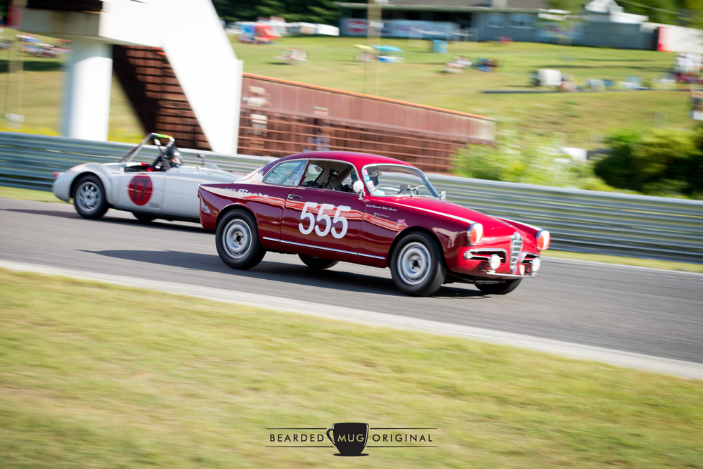 The '555' Alfa taking the inside, and overtaking an MGA, coming into Big Bend at Lime Rock Park.