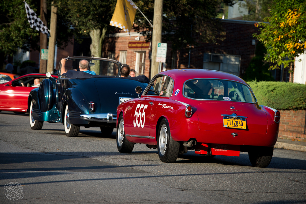 Despite the race livery, Santo's Alfa is just at home pacing behind a Packard, as it's seen here on Pine Street in New Canaan, CT.