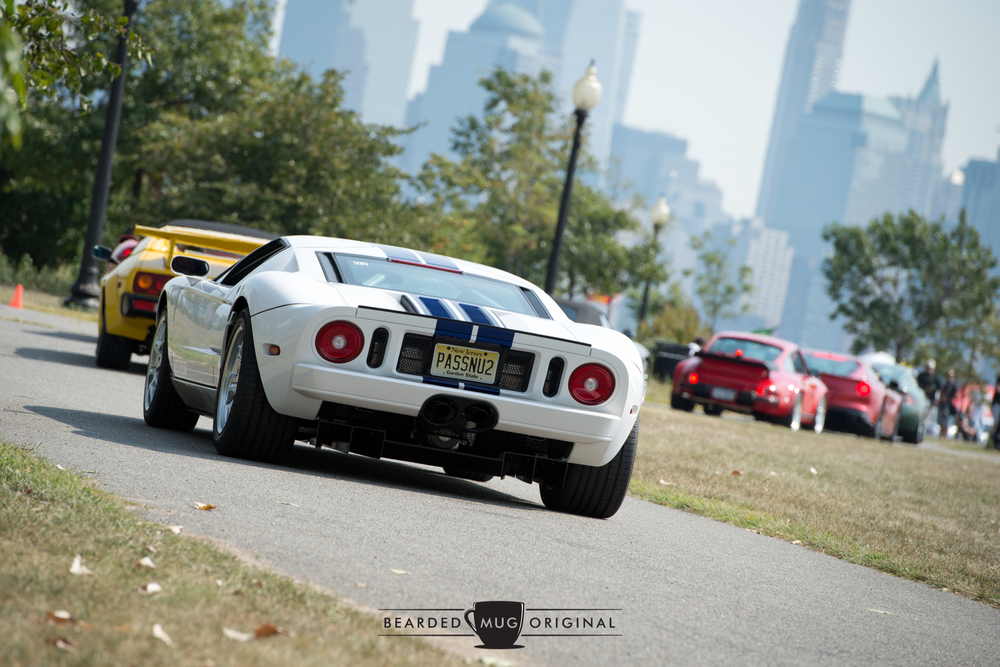 Despite the suggestive vanity plate, this White GT is pulling up the rear of this supercar convoy.