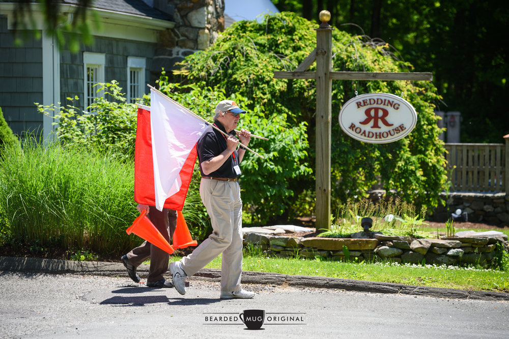 Rich Taylor, of Vintage Rallies, readies the flags to alert the drivers of the chow stop.
