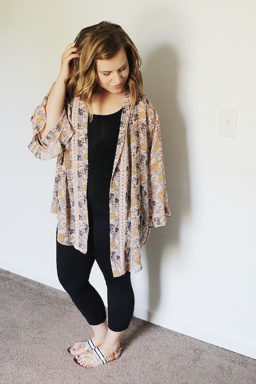 Black yoga pants, black tank, kimono, sandals