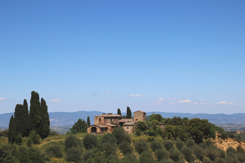 Tuscan Villa A villa sitting high atop the Val D'orcia, the green valley in Siena cradled by towns Pienza, Montalcino and Montepulciano