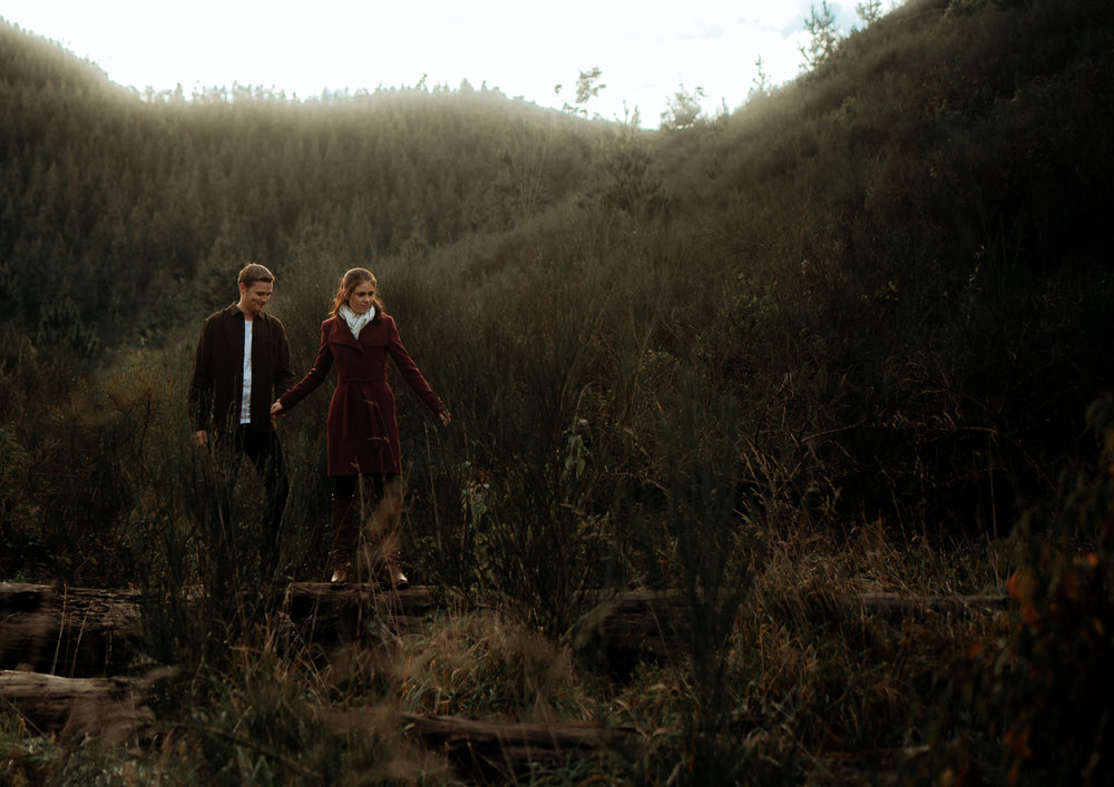 Match your outfit to the location of which your photos will be taken. For Example: The Brown toned that Ben wears really compliment the natural environment in the background. Rosie's maroon trench coat adds a pop of colour without being distracting and also compliments the red/orange tones in the background.