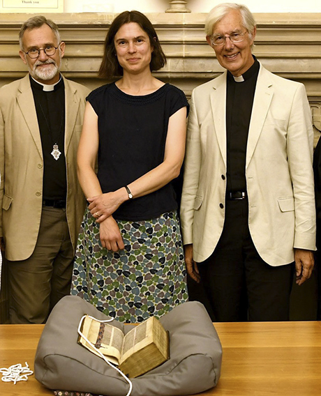 The Lyghfield Bible returns to Canterbury Cathedral, much to the delight of (left to right) the Canon Librarian, the Revd Tim Naish; Head of Archives and Library Mrs Cressida Williams; and the Dean of Canterbury, the Very Revd Robert Willis. [Photo: Canterbury Cathedral]