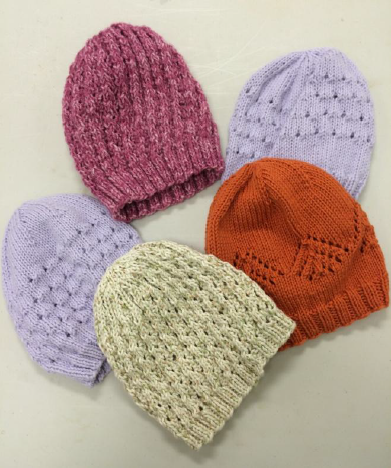 Jane whipped up a quintet of charity chemo caps from leftover yarn.