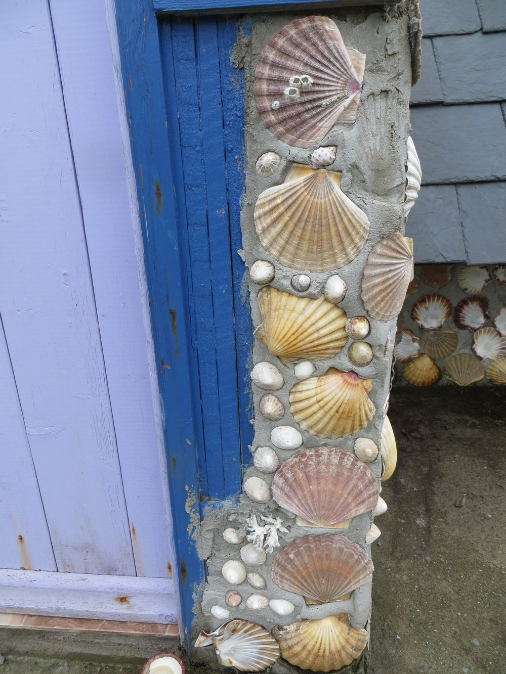 At the entrance of her shell house is this sculpture