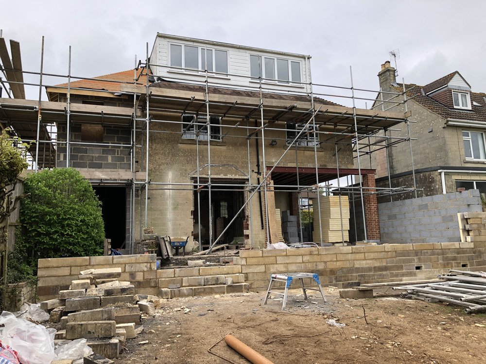 New steelwork and brick piers supporting the corner of the existing house.