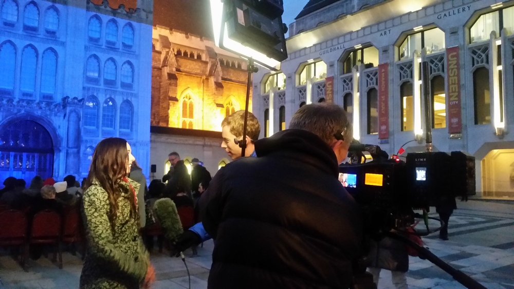 On the job. Live report for ITV London from Guidhall.