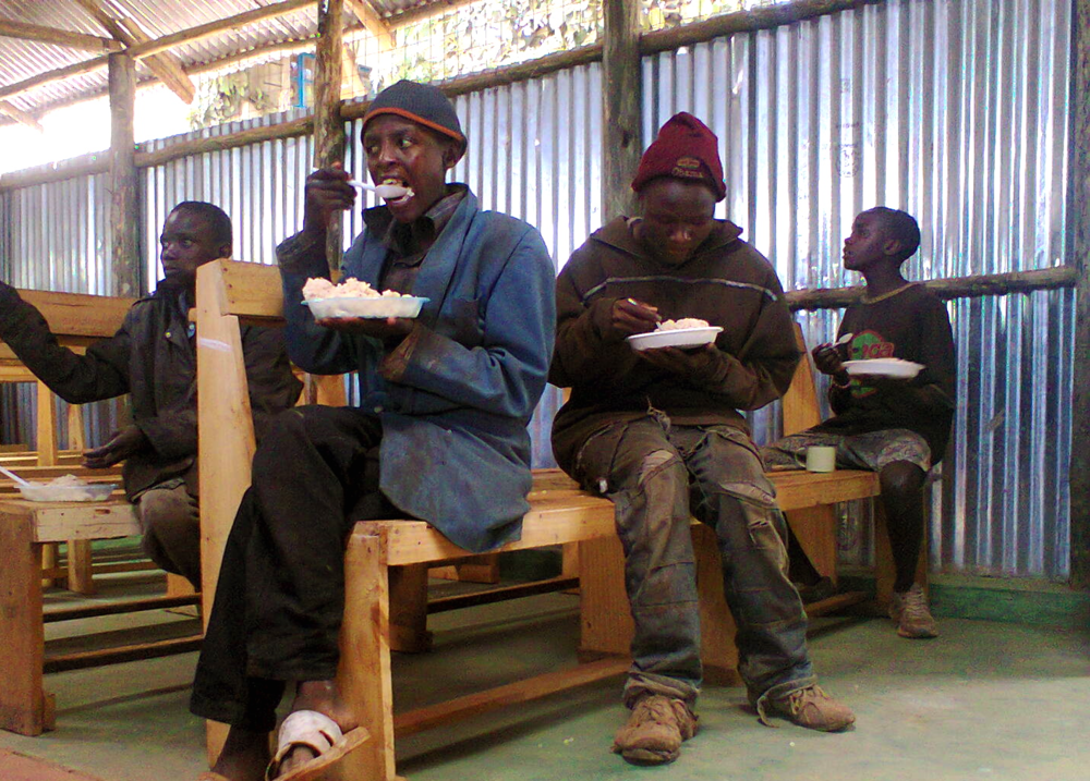 boys enjoying lunch.jpg