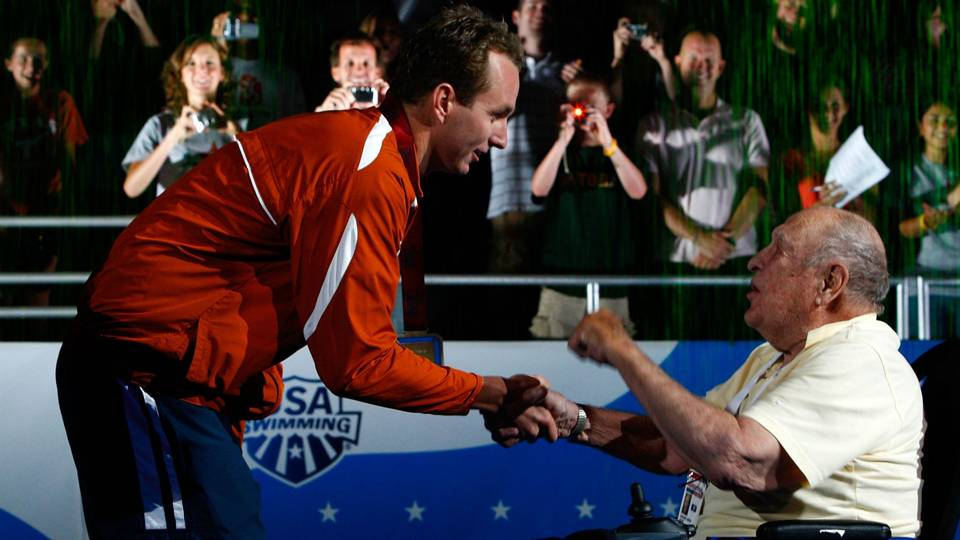 The 1936 Longhorn  1st Olympic gold medalist in the 100m back (Kiefer) greets Peirsol the Longhorn 2008 Olympic gold medalist in that event.