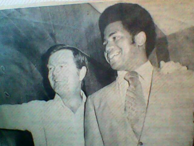 Longhorn Coach Al Matthews with Head Coach Darrell Royal.  -