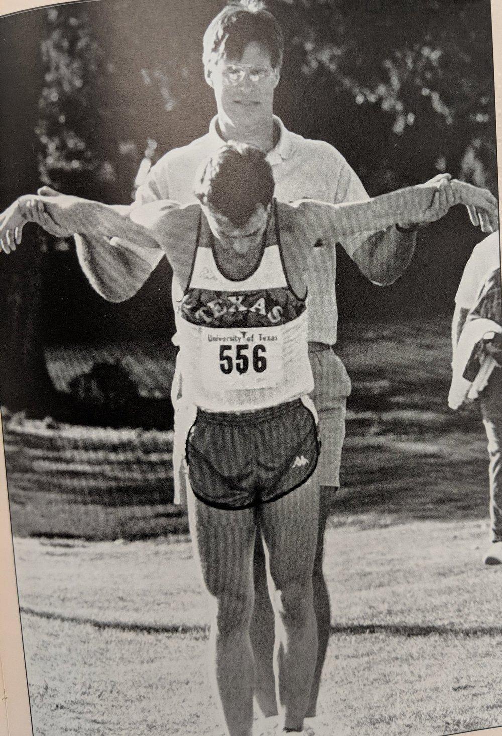 Trainer helping athlete