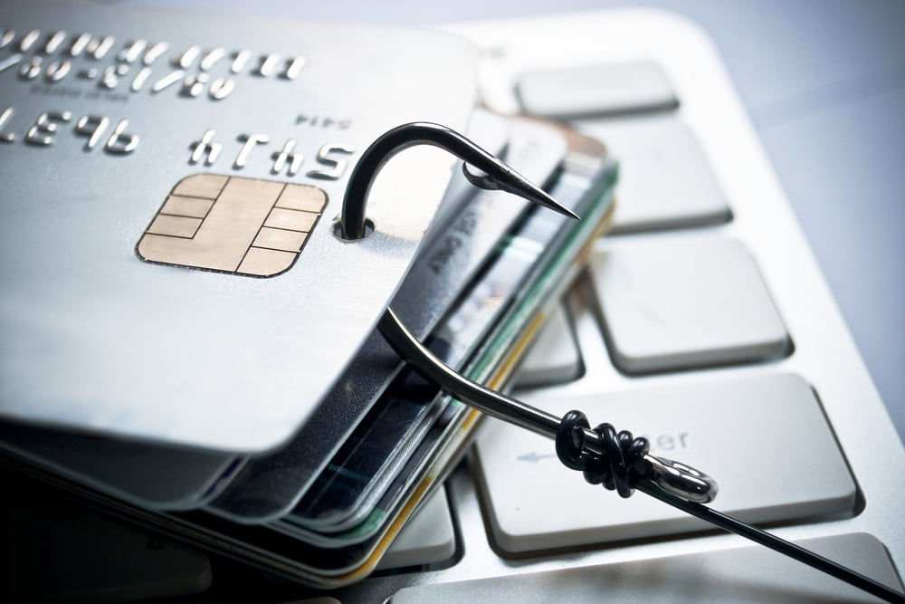 A bunch of debit cards on a hook, indicating fraud