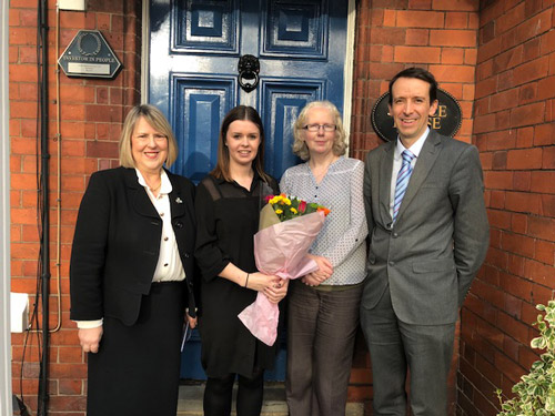 Emily Jordan welcomed into team outside Fiona Bruce Solicitors' offices in Warrington