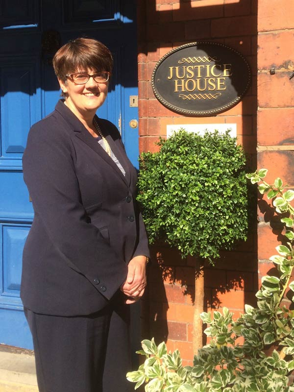 Jenny Gilbertson outside Fiona Bruce Solicitors' offices in Warrington