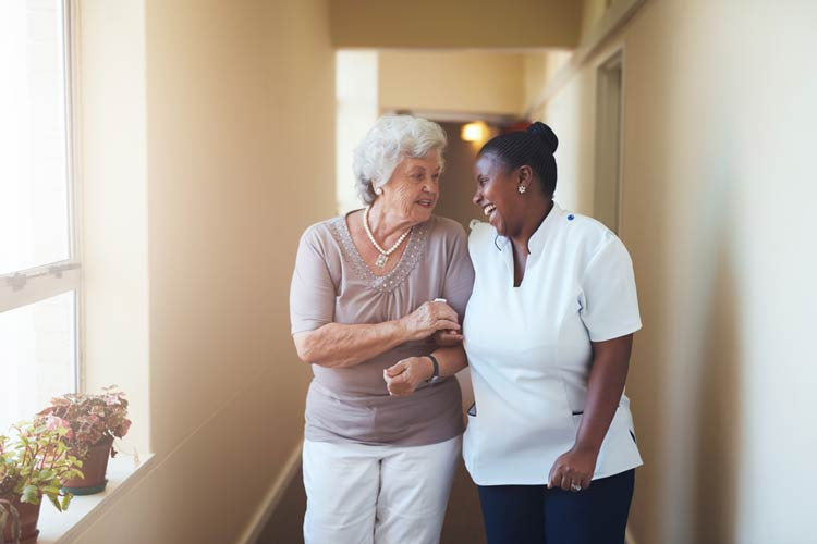 A nurse helping a care patient