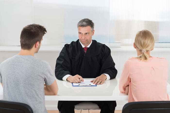 A solicitor sat in front of a divorcing couple