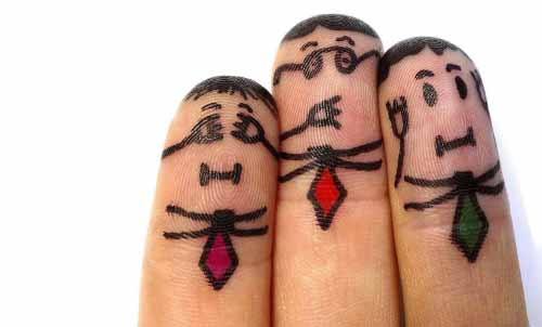 Three fingers drawn on to look like businessmen