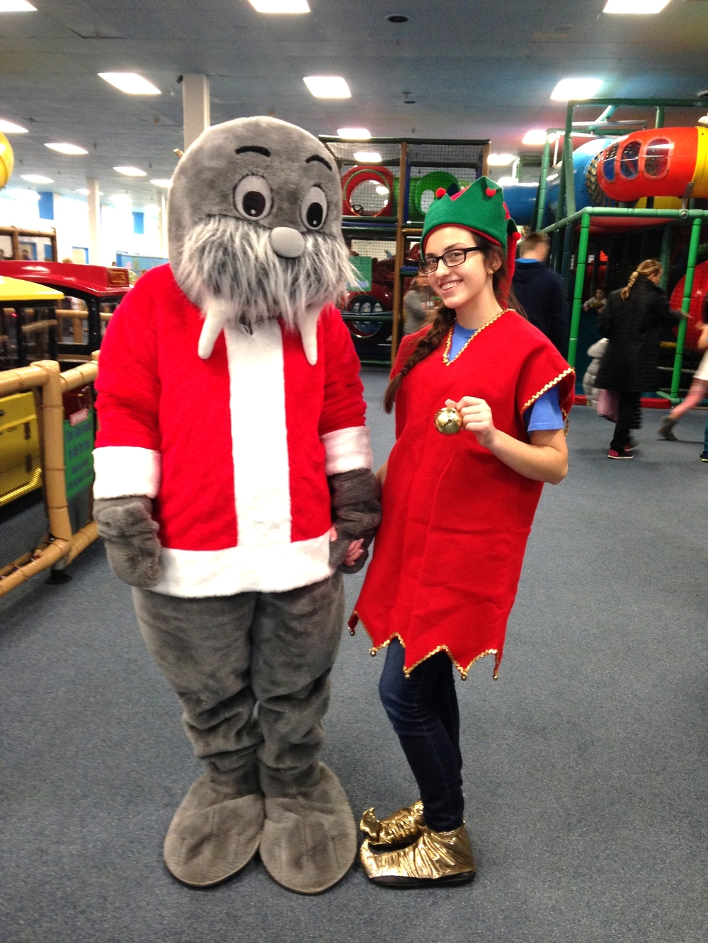 Wally the Walrus dressed for Christmas with one of our elves