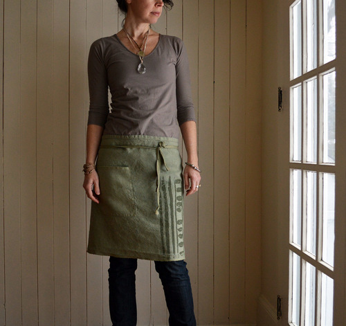 'Mai' moss green hemp half apron - worn with large vintage glass pendant necklace and Kanae wrap bracelet. all handmade by Untold Imprint