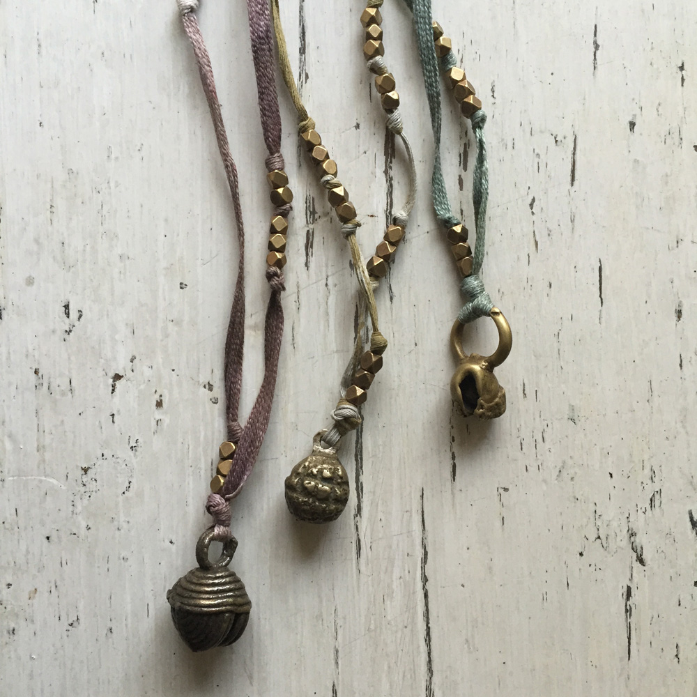 vintage brass bells and Lisu button textile necklaces