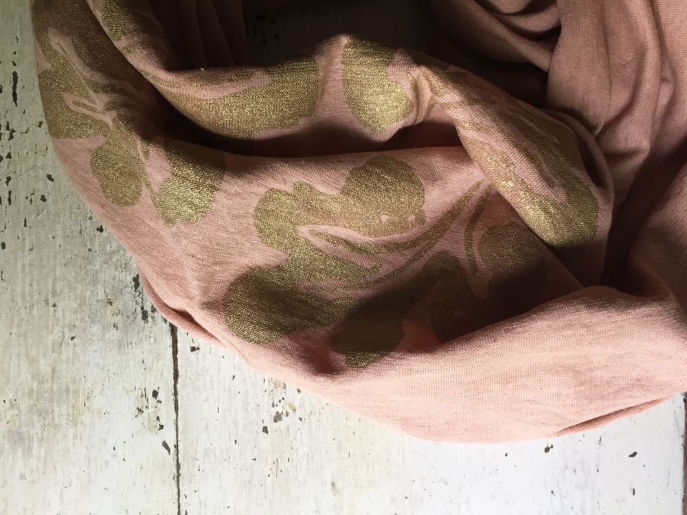 hemp/organic cotton jersey circle scarf dyed with avocado seeds and skins, printed with metallic gold ink.