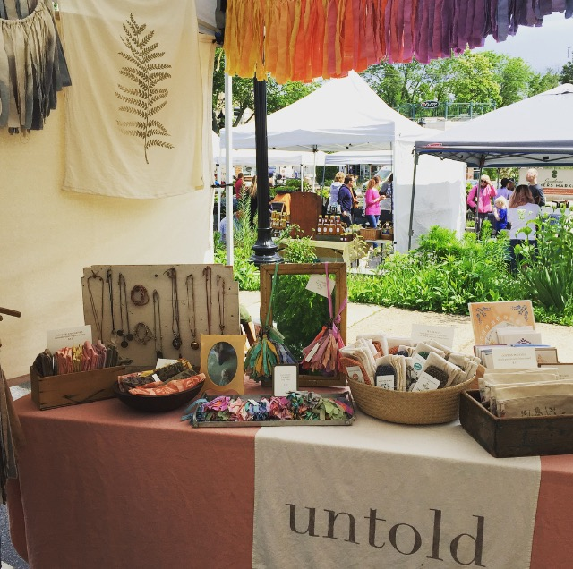 Untold Imprint shop at an outdoor market.