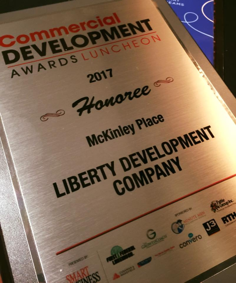 Congratulations to McKinley Townhomes of Lakewood —Built by Liberty Development Company for winning the 2017 Commercial Development 'Honoree' Award!   Lakewood is known as the City of Homes because of its wide variety of housing types and sizes, many of which were built prior to 1940. The idea behind McKinley Place was to turn the nearly 3-acre site that was home to the former McKinley Elementary School into a productive part of the community once again.  Construction on the 40-unit attached townhome neighborhood on Lakewood's west side began in October 2015. It was a joint effort between the city, the Lakewood Board of Education and Liberty Development Co., which is led by President Tom Kuluris.  One of the challenges on the project was to develop a design that was complementary to the Detroit Avenue commercial district as well as the existing residential neighborhood. This would have to be done on an unusually shaped parcel without the benefit of tax abatement.  The city clearly outlined these parameters from the beginning, facilitating an open and collaborative partnership between the city and Liberty Development. The units have been selling and the success of McKinley Place has prompted other communities to approach Liberty about partnering to use the same approach and creative design to build new in-fill neighborhoods in their cities.