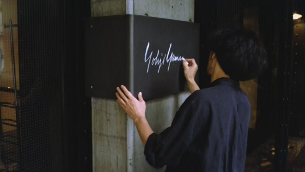 Yohji Yamamoto signing one of his stores.