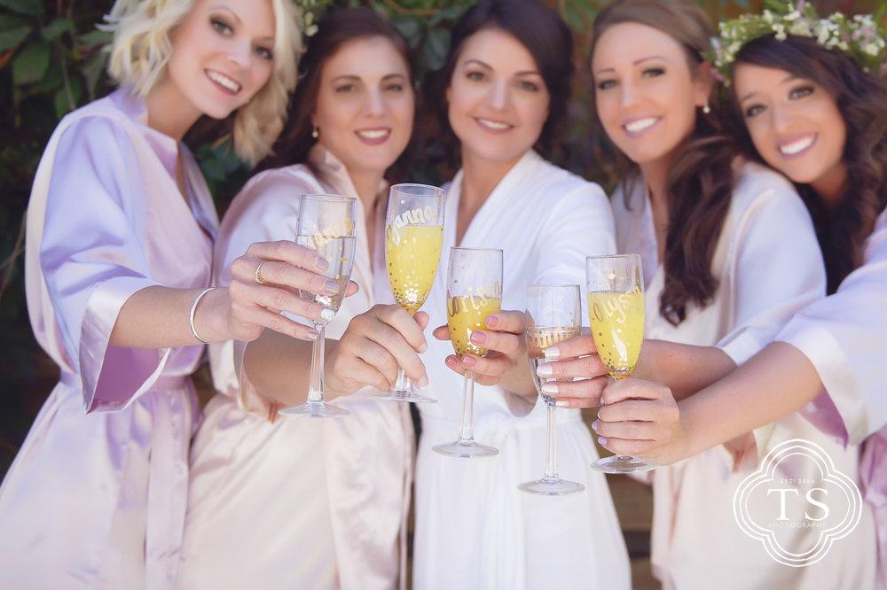 Bridesmaids cheers before wedding