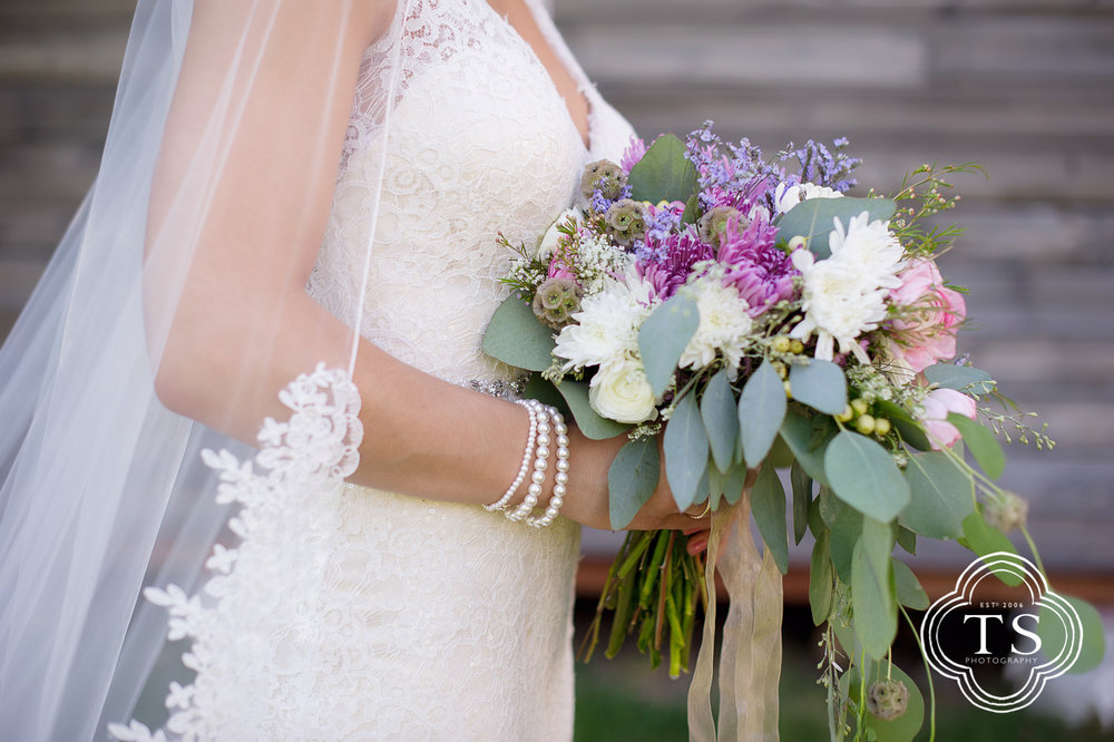 bride and her boquet in red lodge