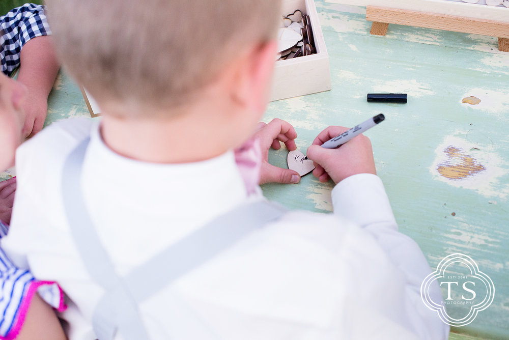 Ring Bearer signing his name in the bridal album just afte the wedding