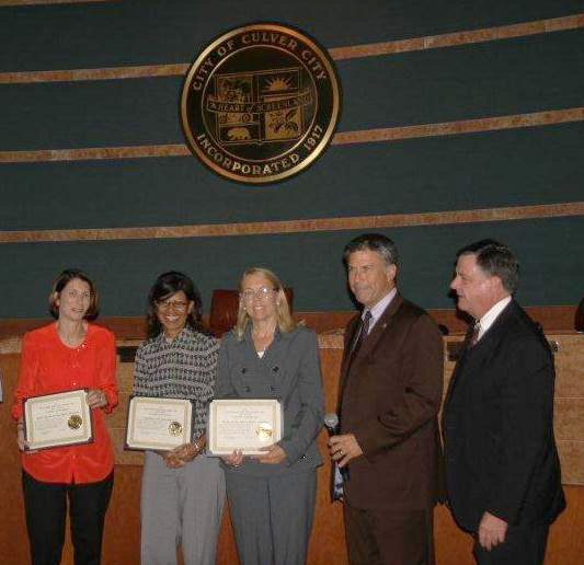 Commissioner-Musicant-and-Board-Member-Christine-Hardin-receiving-Certificates-in-2013-1fixed2.jpg
