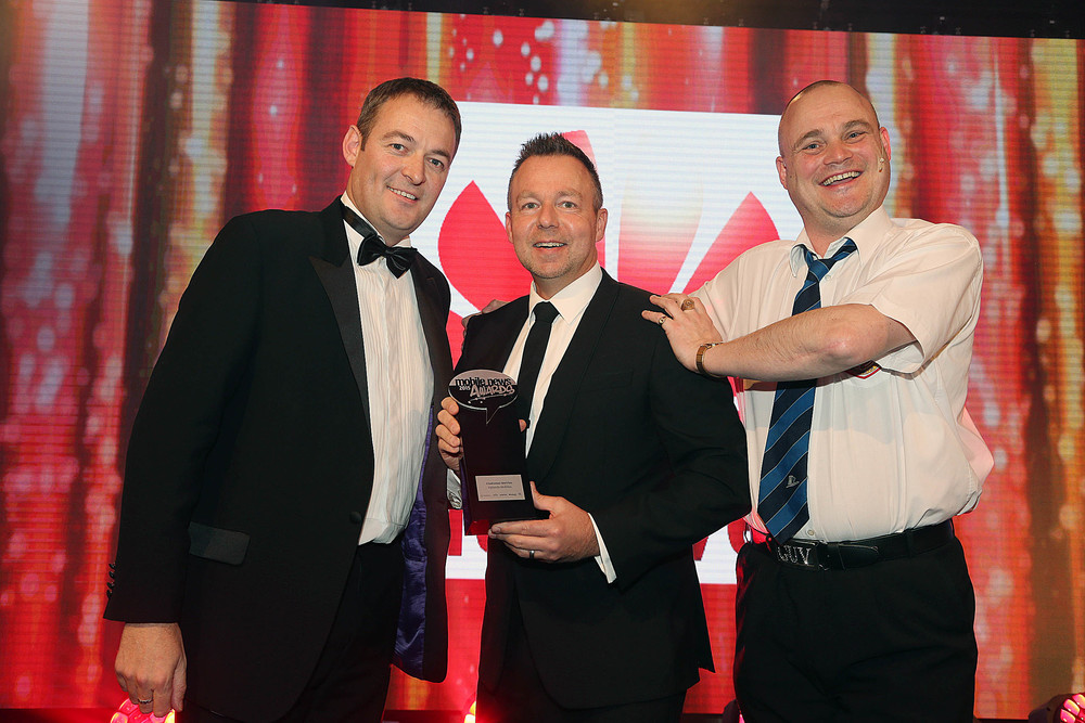 Paul Hooper - Managing Director - Uplands Mobiles Ltd,  collecting the Best Customer Service Award