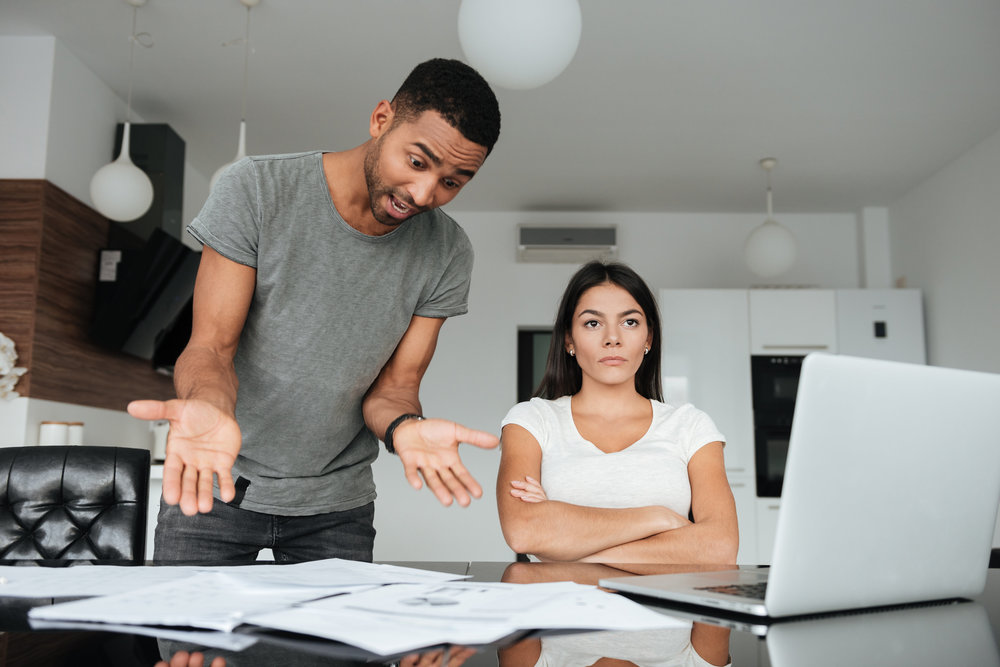 rsz_graphicstock-image-of-loving-couple-discussing-about-domestic-bills-at-home-woman-seriously-look-aside-man-screaming-to-woman-while-holding-documents_sukqjfmohe.jpg