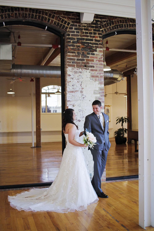 Revolution Mill wedding first look by Kayli LaFon Photography