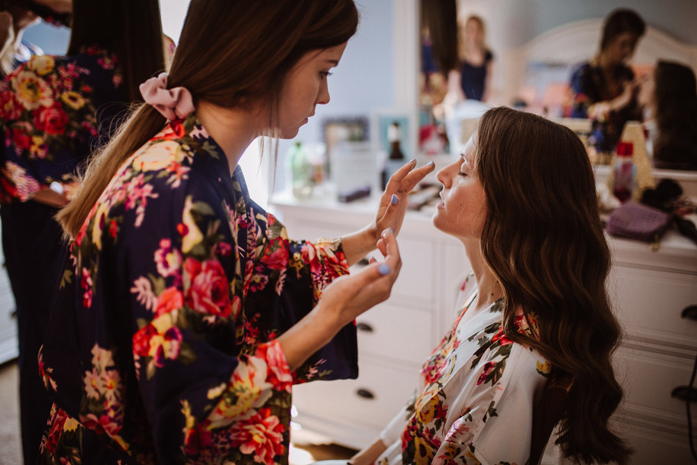 Bride getting ready with Bridesmaids by Kayli LaFon Photography